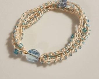 Tan and blue slip on crocheted bracelet