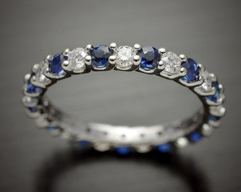 14kt White Gold Eternity wedding band with diamonds and precious stones