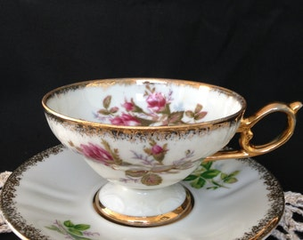 Japan cup and saucer, Floral pattern, Split handle, Gold gilding, Hand painted