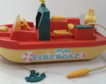 """Toy Fireboat 12"""" long, 6"""" wide approximately."""
