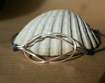 Rose Gold and Silver Wire Love Knot on Grey Cord Adjustable Bracelet.