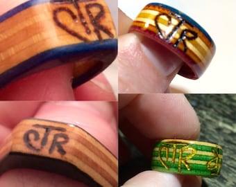 Custom engraved/woodburn recycled skateboard Rings