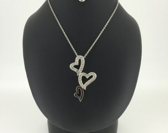 Sterling silver Heart shaped pendant set with cubic zirconias on a matching Sterling silver chain