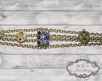 Chain Bracelet with Cogs and Purple Gem Detail