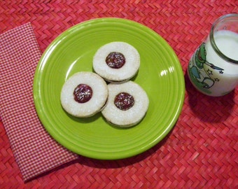 An afternoon snack sure to please your child.  These are jelly filled and topped thumb print cookies right out of the oven.