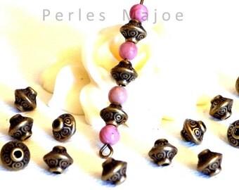 Lot de 10 perles en métal forme toupie décorées couleur bronze style tibétain 6.5 x 7 mm