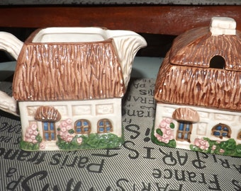 Vintage (c. late 1960s) Giftcraft figural cream and covered sugar bowl set in the shape of cottages.  Made in Taiwan. So cute!
