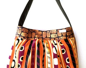 Tribal Tote/Hobo Fabric and Leather Bag. Handmade by Orange bicycle designs.