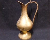 Marked brass vase from India with engraved floral pattern.