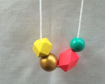 Wooden bead necklace // Geometric and round wooden beads // hot pink, yellow, aqua and gold // hand painted