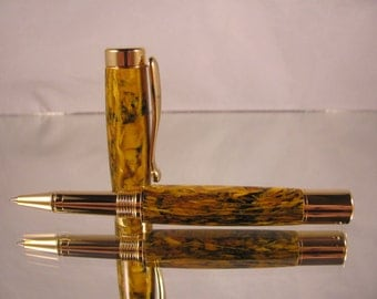Atrax rollerball pen. Gold and yellow colored pressed wood.