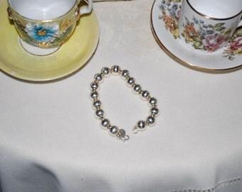 "Tiffany & Co. 925  beaded bracelet, 7.5""L, designer piece, 10mm sterling silver beads"