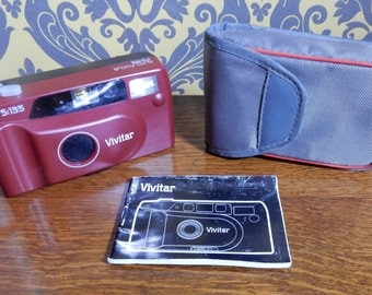 A Vintage Vivitar Camera ,With Case , Collectable, retro and cool thing to have.