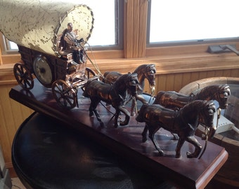 Old Covered Wagon with Horse team Clock