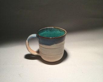 Sandy mug with blue rim