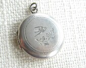 vintage round locket ~ stamped SILVER ~ Swallow engraved front ~ inA76115