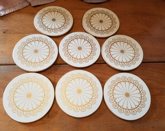 Set of 8 Lady Clare drink coasters gold design