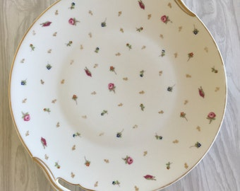 Wonderful unique Limoges serving / cake plate in perfect condition with dainty flowers and gold trim on the rim.