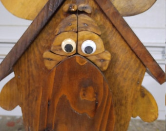 Moose , stained , bird house