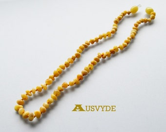 Butter color Baltic amber necklace for kids. Children' jewelry. Butter color. Baltic amber necklace. Knotted. 36 cm (~14 inch). 2108