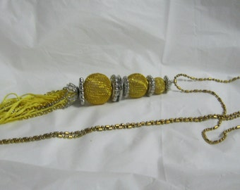 Necklace gold and silver tone tassel