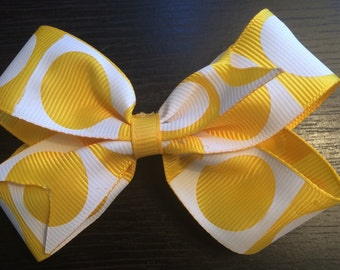 Yellow and white polka dot boutique bow