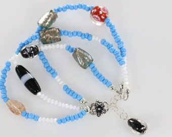 Sale Item-White Swarovski Crystal, Turquoise Blue Glass, and Other Glass Beads Sterling Silver Three Strand Bracelet
