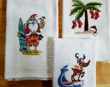 Embroidered Kitchen of Bath Hand Towels Surfing Santa and Reindeer with a Tropical Christmas Palm Tree Set of three