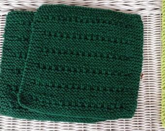 Hand knitted dark green dishcloth