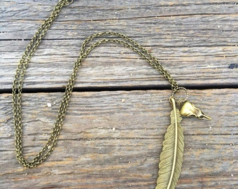 Brass feather and brass bird skull necklace