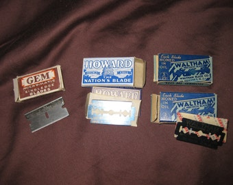 group of vintage razor blades with boxes