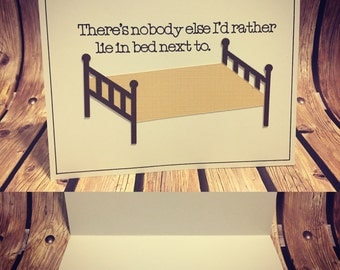 """Naughty Love Greeting Card """"There's nobody else I'd rather lie in bed next to. While looking at my phone."""""""