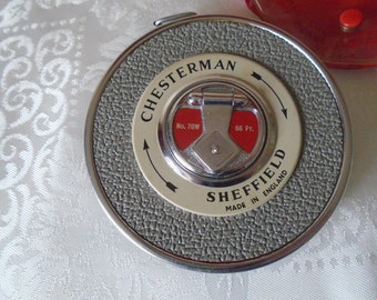 vintage  chesterman's 66 ft tape measure in original case.