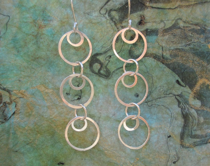 Simple rings earrings of lightly hammered sterling silver