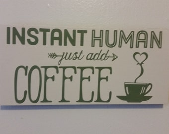 """Wooden """"Instant human: just add coffee"""" sign"""