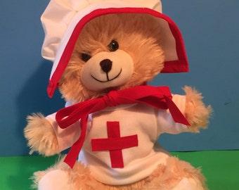 Adorable teddy bear dressed in a Red Cross Clara Barton costume/plush teddy