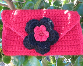 Hand crocheted Clutch bag in  in red and black with detachable flower brooch