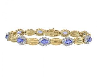 0.75 Carat Diamond and 4.50 Carat Tanzanite 14K Yellow Gold Fancy Link Bracelet