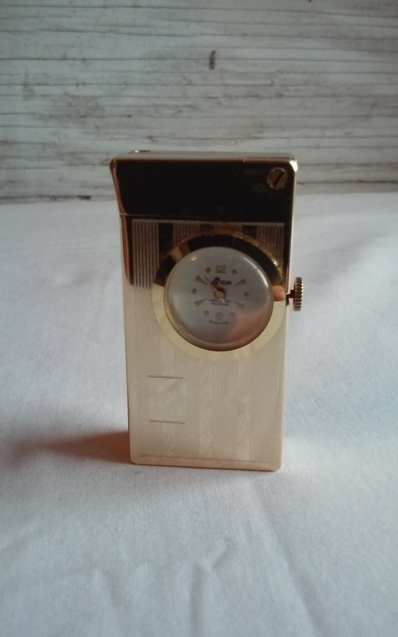 Vintage 1960s Rivo Swiss Made Ladies Lighter/Clock.   Beautiful Goldtone lighter.  Swiss Made. The Clock would not set.  Clock is by Nelson.