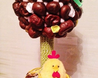 Funny yellow topiary with chestnuts, decorfor home