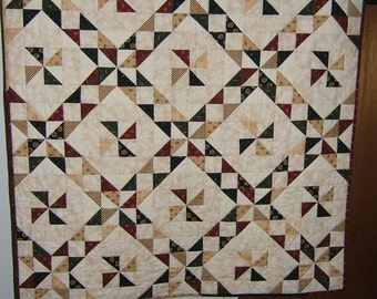 Quilted Wall Hanging , Half square triangles rich colors with white background