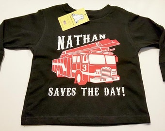 """Firetruck - Your child's name """"Saves The Day!"""" on Short or Long Sleeve Toddler T-shirt or a warm Pullover Hoodie"""