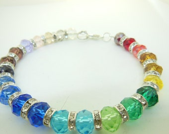 Rainbow, multi colored  8mm rondelle swarovski crystal bracelet with silver spacers