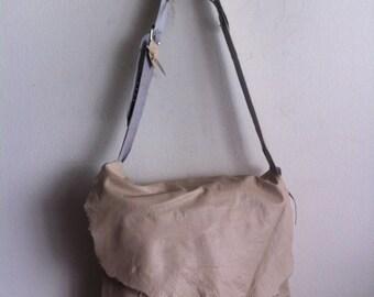 Beige large shoulder bag on a long strap, a bag made of genuine leather.