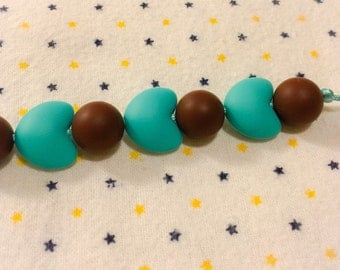 Turquoise/Brown Cupid Teething Necklace