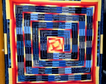 Modern art quilt of original design that is double-sided, handmade, and finished using free-motion design machine quilting