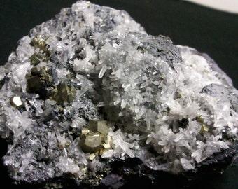 Pyrite on quartz and Galena
