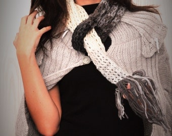 Beautiful handmade cape in grey colour, which will definitely emphasize your femininity