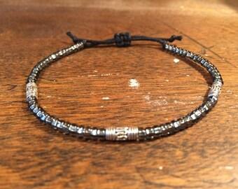 Single strand grey bracelet