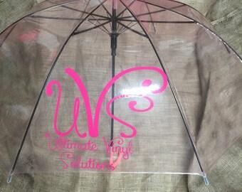 Tranparent umbrella with monogram.